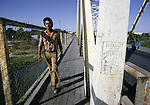A Mexican day worker crosses U.S. Border in Del Rio, Texas.  While the traditional mission of the United States Border Patrol has always been the detection and prevention of the illegal entry of aliens and smuggling of illegal contraband into the United States anywhere other than a designated port-of-entry, the dawn of the age of terrorism within our nation has added a new and high priority mission: to detect and prevent the entry of terrorists and their weapons into the United States. Jim Bryant Photo..©2006. All Rights Reserved.