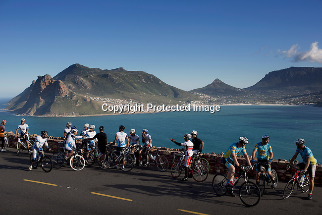 Bicyclists take a break on Chapmans Peak road outside Hout Bay Cape Town, South Africa. The city has become one of the worlds must see cities, with its natural beauty, beautiful weather and reasonable priced restaurants. (Photo by: Per-Anders Pettersson)