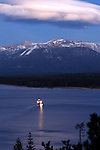 """""""Freel's Queen"""" Freel Peak- Lake Tahoe, CA.  The Tahoe Queen passes by at dusk with Freel Peak in the background.  A huge lenticular cloud is breaking apart after a spectacular display throughout the day.   The limited edition series of 250 size for this image is 27""""x40"""" which is it's maximum size and comes with a certificate of authenticity."""