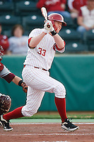 Cameron Seitzer (33) follows through after hitting during the NCAA matchup between the University of Arkansas-Little Rock Trojans and the University of Oklahoma Sooners at L. Dale Mitchell Park in Norman, Oklahoma; March 11th, 2011.  Oklahoma won 11-3.  Photo by William Purnell/Four Seam Images