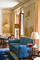 The living room displays original 1920s trompe l'oeil which has been successfully restored