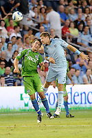 Luke Sassano (32) midfielder Sporting KC wins the aeriel battle against Servando Carrasco (23) midfielder Seattle Sounders..... Sporting Kansas City were defeated 1-2 by Seattle Sounders at LIVESTRONG Sporting Park, Kansas City, Kansas.