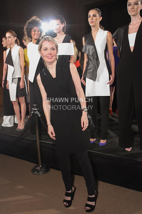 Fashion designer Vassa, poses with models during her Vassa & Co. Spring Summer 2016 collection presentation.