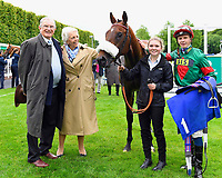Winner of The First Carlton Novice Auction Stakes Div 2 Grove Ferry ridden by David Probert and trained by Andrew Balding with Owners , Lass and Jockey in the Winners Enclosure during Evening Racing at Salisbury Racecourse on 11th June 2019