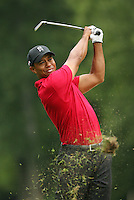 BETHESDA, MD - JULY 5 : Tiger Woods hits his third shot on the 11th hole during the final round of the AT&T National hosted by Tiger Woods at Congressional Country Club on July 5, 2009 in Bethesda, Maryland. (Photo by Hunter Martin/Getty Images) *** Local Caption *** Tiger Woods