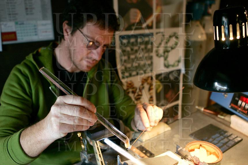 Davide Penso al lavoro nel suo laboratorio di gioielli in vetro, a Murano, Laguna di Venezia.<br /> Glass jewelry designer Davide Penso works in his  laboratory shop in Murano, Venice's Lagoon.<br /> UPDATE IMAGES PRESS/Riccardo De Luca