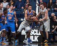 Jabari Bird of California fights for a jump ball against Kyle Anderson of UCLA during the game at Haas Pavilion in Berkeley, California on February 19th, 2014.  UCLA defeated California, 86-66.