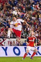 Kenny Cooper (33) of the New York Red Bulls heads the ball. The New York Red Bulls defeated Toronto FC 4-1 during a Major League Soccer (MLS) match at Red Bull Arena in Harrison, NJ, on September 29, 2012.