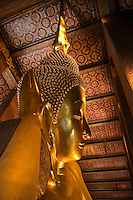 The largest RECLINING BUDDHA in THAILAND (46 meters long) is found at the THERAVADA BUDDHIST TEMPLE of WAT PO - BANGKOK, THAILAND