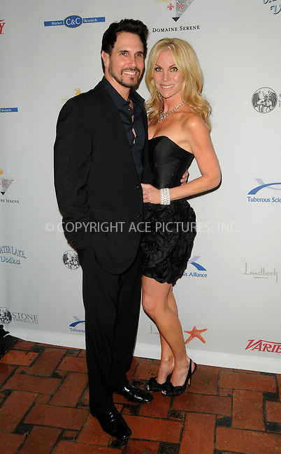 WWW.ACEPIXS.COM . . . . . ....April 3 2011, Los Angeles....(L-R) Actors Don Diamont and Cindy Ambuehl arriving at the10th annual Comedy For A Cure at The Roosevelt Hotel on April 3, 2011 in Hollywood, CA....Please byline: PETER WEST - ACEPIXS.COM....Ace Pictures, Inc:  ..(212) 243-8787 or (646) 679 0430..e-mail: picturedesk@acepixs.com..web: http://www.acepixs.com