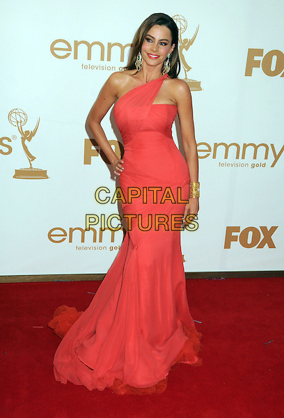 Sofia Vergara (wearing Vera Wang).63rd Primetime Emmy Awards held at Nokia Theatre L.A. Live. Los Angeles, California, USA. .18th September 2011.emmys full length pink red dress one shoulder hands on hips viagra.CAP/ADM/BP.©Byron Purvis/AdMedia/Capital Pictures.
