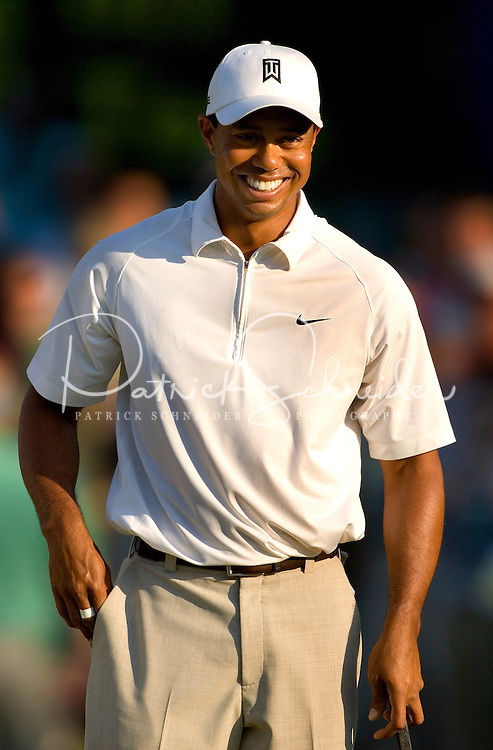 Tiger Woods cracks a smile while playing during the 2007 Wachovia Championships at Quail Hollow Country Club in Charlotte, NC.