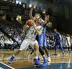 SIOUX FALLS, SD - NOVEMBER 30:  Cody Larson #34 from South Dakota State University eyes the basket after getting a step past Nate Hicks #1 from Florida Gulf Coast in the first half of their game Sunday afternoon at the Sanford Pentagon in Sioux Falls. (Photo by Dave Eggen/inertia)