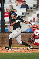 Julio De La Cruz (29) of the Bristol Pirates follows through on his swing against the Johnson City Cardinals at Howard Johnson Field at Cardinal Park on July 6, 2015 in Johnson City, Tennessee.  The Pirates defeated the Cardinals 2-0 in game one of a double-header. (Brian Westerholt/Four Seam Images)
