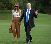 United States President Donald J. Trump and First Lady Melania Trump hold hands as they walk across the South Lawn as they and their son Barron Trump return to the White House in Washington, DC, after a trip to New Jersey, June 11, 2017. Photo Credit: Chris Kleponis/CNP/AdMedia
