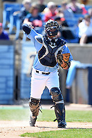 Wilmington Blue Rocks catcher Cam Gallagher (35) throws to first during a game against the Myrtle Beach Pelicans on April 27, 2014 at Frawley Stadium in Wilmington, Delaware.  Myrtle Beach defeated Wilmington 5-2.  (Mike Janes/Four Seam Images)