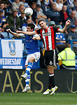 Kieran Lee of Sheffield Wednesday and Chris Basham of Sheffield Utd during the Championship match at the Hillsborough Stadium, Sheffield. Picture date 24th September 2017. Picture credit should read: Simon Bellis/Sportimage
