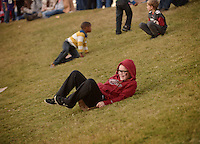 NWA Democrat-Gazette/BEN GOFF @NWABENGOFF<br /> Ansley Wilkins, 10, of Ozark, Mo. slides on Saturday Nov. 12, 2016 on the grassy hill on the North end of Razorback Stadium in Fayetteville before the Arkansas football game against LSU.
