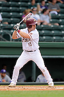 Second baseman Wil Leathers (15) of the Elon Phoenix bats in a game against the Furman Paladins in a first-round Southern Conference playoffs game on Wednesday, May 22, 2013, at Fluor Field at the West End in Greenville, South Carolina. Furman won, 10-1. (Tom Priddy/Four Seam Images)