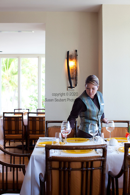The Kahala Resort and Hotel, located in Honolulu on the souths side of Diamond Head, offers luxurious accommodations and is the only hotel in Oahu with a dolphin program. Preparing for evening meal service at Hoku's restaurant.