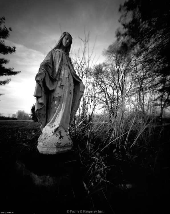 A statue of the Virgin Mary watches over the back yard of a home in Flushing Township, Michigan