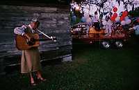 Tuning her guitar backstage, a musician prepares for a concert for the Tatum family reunion. Up to 1000 relatives gather at the homestead annually near the Okefenokee Swamp.