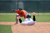 GCL Astros second baseman Alfredo Angarita (2) tags Victor Mesa Jr. (9) out on a stolen base attempt during a Gulf Coast League game against the GCL Marlins on August 8, 2019 at the Roger Dean Chevrolet Stadium Complex in Jupiter, Florida.  GCL Astros defeated GCL Marlins 4-2.  (Mike Janes/Four Seam Images)