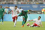 19 August 2008: Anthony Vanden Borre (BEL) (16) and Sepp De Roover (BEL) (2) try to stop Victor Obinna (NGA) (9).  The men's Olympic soccer team of Nigeria defeated the men's Olympic soccer team of Belgium 4-1 at Shanghai Stadium in Shanghai, China in a Semifinal match in the Men's Olympic Football competition.