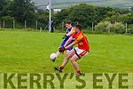 Ballymacelligott's Max O'Brien is denied a goal as Valentia's Shane O'Connor makes fingertip contact to sent the ball out for a forty five.