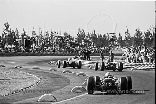 Trio of F1 cars in Esses, 1965 Mexican GP, with Jackie Stewart in his BRM leading the Ferraris of John Surtees and Lorenzo Bandini.