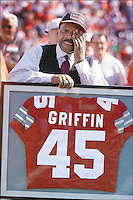 Former OSU football player Archie Griffin wipes a tear during a halftime ceremony in which his jersey number, 45, was retired Oct. 30, 1999. First ever at OSU. Columbus Dispatch, Fred Squillante<br /> <br /> Two-time Heisman Trophy winner Archie Griffin wipes a tear during a surprise halftime ceremony in which Ohio State retired his jersey number. Griffin said the honor is &quot;very much at the top&quot; of his list of career highlights. The Buckeyes defeated Iowa 41-11. &hellip;.   Not that there was a lot of doubt, but Archie Griffin and his No. 45 are officially No. 1 at Ohio State. The university, beginning a new tradition, retired the two-time Heisman Trophy winner's No. 45 jersey yesterday in a surprise halftime ceremony. Griffin is the first athlete whose number has been officially retired by Ohio State.