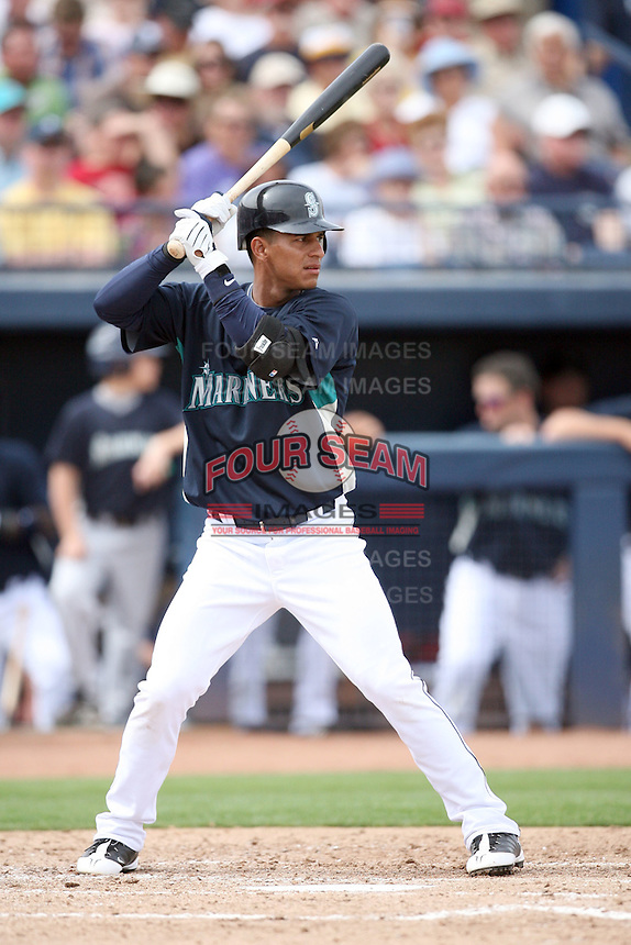 March 8, 2009: Ronny Cedeno (3) of the Seattle Mariners at Peoria Sports Complex in Peoria, AZ.  Photo by: Chris Proctor/Four Seam Images