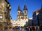 Tourists in Old Town Square with Tyn church and astronomical clock, Prague, Czech Republic