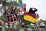 (From Right) Alexa Haight, 13,  and Cassia Giustra, 13, scream while riding a ride during the NV150 Fair at Fuji Park in Carson City, Nev., on Sunday, August 3, 2014.<br /> (Photo By Kevin Clifford)