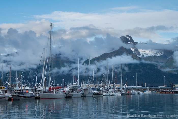 Misty mountain rising above Seward Small Boat Harbor, Seward, Alaska