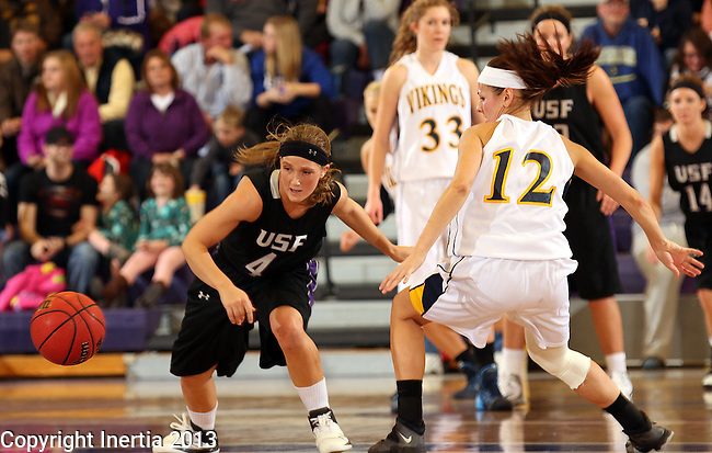 SIOUX FALLS, SD - DECEMBER 7:  Marie Malloy #4 from the University of Sioux Falls steals the ball from Emily Schulte #12 from Augustana in the second half of their game Saturday evening at the Stewart Center. (Photo by Dave Eggen/Inertia)