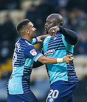 Adebayo Akinfenwa of Wycombe Wanderers celebrates scoring the opening goal with Paris Cowan-Hall of Wycombe Wanderers during the Sky Bet League 2 match between Notts County and Wycombe Wanderers at Meadow Lane, Nottingham, England on 10 December 2016. Photo by Andy Rowland / PRiME Media Images.