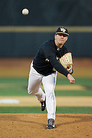 Wake Forest Demon Deacons relief pitcher Nate Jones (42) delivers a pitch to the plate against the Georgetown Hoyas at Wake Forest Baseball Park on February 16, 2014 in Winston-Salem, North Carolina.  The Demon Deacons defeated the Hoyas 3-2.  (Brian Westerholt/Four Seam Images)