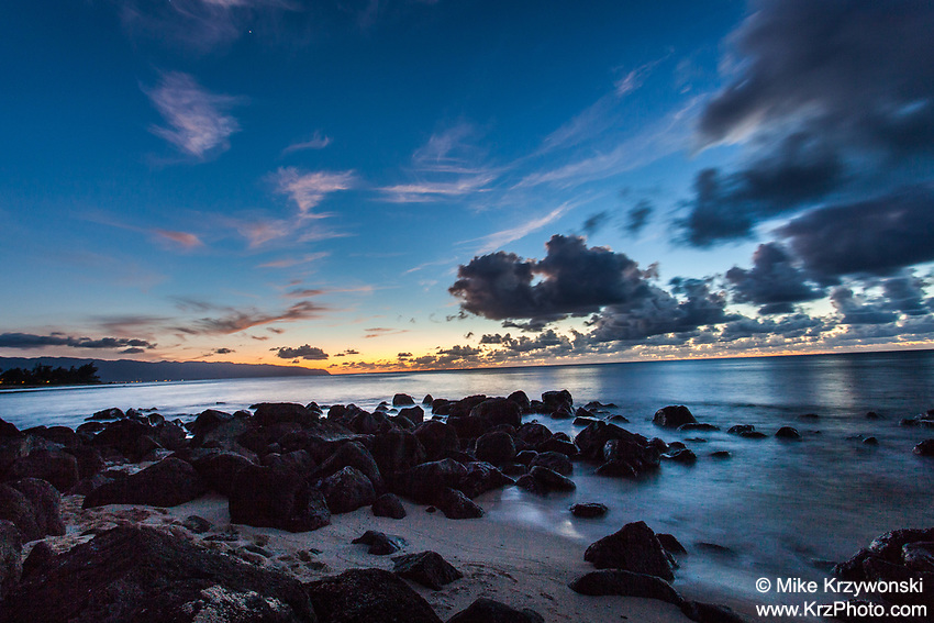 Sunset behind a rocky shoreline at Leftover's Beach, North Shore, Oahu