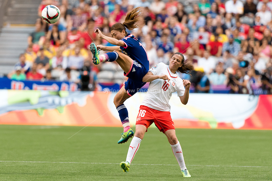 June 8, 2015: Rumi UTSUGI of Japan jumps for the ball during a Group C match at the FIFA Women's World Cup Canada 2015 between Japan and Switzerland at BC Place Stadium on 8 June 2015 in Vancouver, Canada. Sydney Low/AsteriskImages