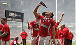 Jamie Roberts celebrates with champagne after Wales secure the 6 Nations Championship and Grand Slam with victory over France..RBS 6 Nations 2012.Wales v France.Millennium Stadium.17.03.12..CREDIT: STEVE POPE-SPORTINGWALES