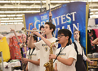 NWA Democrat-Gazette/FLIP PUTTHOFF <br />STRIKE UP THE BAND<br />Connor Hayes (center) performs Tuesday April 10 2018 with the Bentonville Pride Marching Band at the Walmart store at the Pleasant Crossing shopping center in Rogers. The high schoool band was on hand to celebrate the national release of the movie, &quot;The Greatest Showman,&quot; said Alisha Pettigrew, a Bentonville band parent. Students performed the song, &quot;This Is Me,&quot; from the movie. Their performance was filmed as part of a marketing promotion for the movie, store personnel said. Students performed from 5 a.m. to 7 a.m. so shopper traffic wouldn't be impeded, Pettigrew said. Band members are used to early hours from traveling to band competitions, she added.