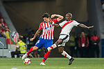 Stefan Savic (L) of Atletico de Madrid vies for the ball with Gael Kakuta of Rayo Vallecano during the La Liga 2018-19 match between Atletico de Madrid and Rayo Vallecano at Wanda Metropolitano on August 25 2018 in Madrid, Spain. Photo by Diego Souto / Power Sport Images