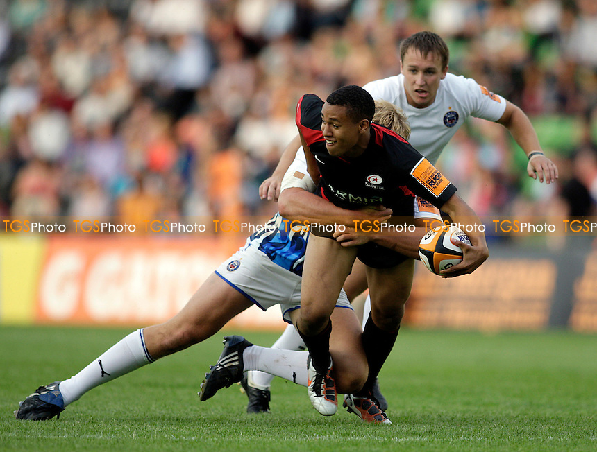 Saracens Marcus Watson offloads in the tackle - JP Morgan Rugby Sevens at Twickenham Stoop - 05/08/11 - MANDATORY CREDIT: Helen Watson/TGSPHOTO - Self billing applies where appropriate - 0845 094 6026 - contact@tgsphoto.co.uk - NO UNPAID USE.