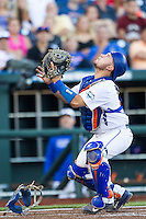Florida Gators catcher Mike Rivera (4) tracks a foul pop against the Miami Hurricanes in the NCAA College World Series on June 13, 2015 at TD Ameritrade Park in Omaha, Nebraska. Florida defeated Miami 15-3. (Andrew Woolley/Four Seam Images)