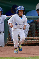 One of the Ogden Raptors bat boys trots onto the field as the Raptors faced the Grand Junction Rockies at Lindquist Field on September 8, 2013 in Ogden Utah.  (Stephen Smith/Four Seam Images)