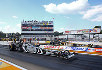 Aug. 16, 2013; Brainerd, MN, USA: NHRA top fuel dragster driver Shawn Langdon (near) races alongside Tony Schumacher during qualifying for the Lucas Oil Nationals at Brainerd International Raceway. Mandatory Credit: Mark J. Rebilas-
