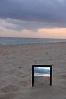Sunrise filmed by a  Digital tablet in sand on beach, Punta Cana, Dominican Republic