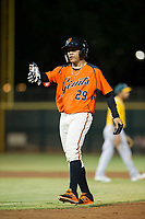 AZL Giants left fielder Ismael Munguia (29) hands his batting gloves to first base coach Bill Horton (not pictured) during the game against the AZL Athletics on August 5, 2017 at Scottsdale Stadium in Scottsdale, Arizona. AZL Athletics defeated the AZL Giants 2-1. (Zachary Lucy/Four Seam Images)