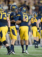 John Sheperdson of California celebrates with California kicker Vincenzo D'Amato after scoring PAT during the game against Northwestern at Memorial Stadium in Berkeley, California on August 31st, 2013.  Northwestern defeated CAL, 44-30.